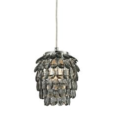 This #mini pendant with a #grey smoked drop gives an elegant gleam lending intimacy and grace to the space.
