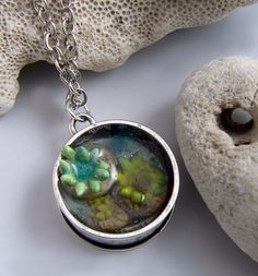DIY!!! click the link for the complete (quick and easy version!) of how to make this fun little tidepool pendant!   #christifriesen #diy #diyResin #resin #pendant #tidepool #polymer #polymerTutorial