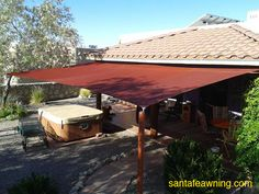 Shade Sail patio cover! Put it up in the spring, take it down in the fall