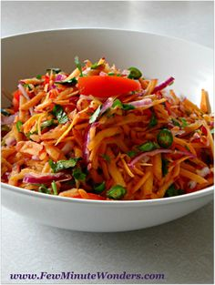 A simple yet delicious Carrot Tomato Salad. Mix shredded carrots, diced tomatoes, shredded firm onion (optional), few drops of lime juice, minced green chilli, salt and a dash of cilantro. Whola!! your salad is ready.