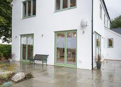 Dual Colour Bi-fold Doors Create A Modern Country Feel White Bifold Doors, Modern Country, Windows, Patio, Colour, Traditional, Contemporary, The Originals, Outdoor Decor