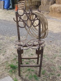 This is a T-post chair made from horse shoes and some t-posts