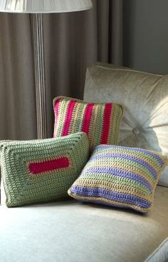 """FREE PTRN DOWNLOAD: EASY CROCHET. 'Colorful Throw Pillows' #LW3529. YARN: Red Heart® With Love®: 1 skein each 1538 Lilac A, 1308 Tan B, 1601 Lettuce C and 1701Hot Pink D (1 skein of each will make all 3 pillows). SIZE: (2)14"""" x 14"""" (35.5 x 35.5 cm) pillow forms; (1) 12"""" x 16"""" (30.5 x 40.6 cm) pillow form."""