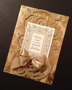 You'll receive this card in a protective cellophane sleeve and with an ivory, gold-foil-lined envelope. Description from etsy.com. I searched for this on bing.com/images