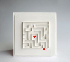Card with a maze ... almost all white ... just two little red hearts ... intriquing ...