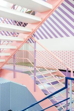 A creative space created by the power of pastel colours. A retro stripe and blush pink stairway creates such a unique interior!