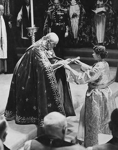 The coronation of Queen Elizabeth II in Westminster Abbey, London, 2nd June 1953. The Archbishop of Canterbury, Geoffrey Fisher, presents the Queen with the Sceptre with the Cross. Photo: Hulton Archive/Getty Images.
