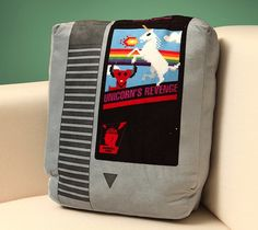 These cartridges are cuddly and soft and make perfect throw #pillows, nap pillows, or butt pillows for wee #geeks who are sitting on the floor starting their love affair with #gaming. http://thegadgetflow.com/portfolio/retro-video-game-cartridge-pillow-set-40/