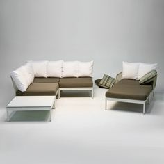 Lodge 3-seater sofa arranged into a corner-sofa configuration, with Chaise Sectional -  Made in Germany by FISCHER MÖBEL. Modern and familiar, pairs fine wickerwork with soft outdoor cushions covered in Sunbrella fabric. Comfortable as it is re-arrangable. Shift the arms and back to create a chaise and armchair pair, or separate the cushions to create three isolated seats for those evening fire-pit parties. The soft cream color of the frame blends with many other styles
