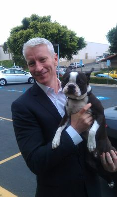 How to love Anderson Cooper even more?  Put a Boston in his arms!