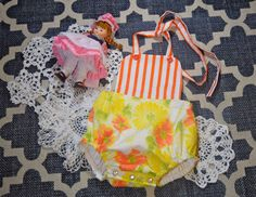 Cute up-cycled vintage inspired romper for a baby. 0-3 months.