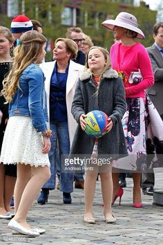 Dutch Royal Family Attend King's Day 2016 in Zwolle. Princess Alexia and Princess Ariane oplay with a ball during King's Day