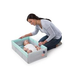 Now nap time can go wherever you go! The 2-in-1 Travel Bed and Play Mat™ is both a large Play Mat and a portable travel bed. Sides connect to provide a secure place for baby to nap or relax. Folds compactly and has a handle for convenient transport. Machine-washable fabrics in a great fashion make this ideal for trips, family visits and any time baby needs to nap away from home.<br><br>The Ingenuity 2-in-1 Travel Bed and Play Mat Features:<br><ul><li>Lar...