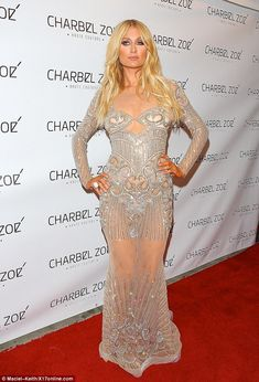 Transparent: Paris Hilton hit the red carpet in Los Angeles on Tuesday night wearing a com...