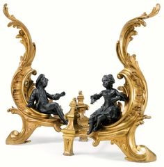 A pair of bronze and gilt-bronze chenets in Louis XV style (19th century).