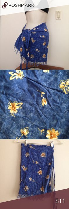 Swimsuit tie sarong blue  and tan floral print Thai so long with pattern as shown. Blue color is like a denim. Patterns are tan  florals. Light blue fringe bottom. 44 inches wide +20 inch tie length (two of these).16.5 inch length. Good condition. Rayon. Swim Sarongs