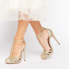 """Vintage Inspired Gold Glitter Heels Gorgeous gold glitter pin-up style T-strap heels with strappy front and buckle at ankle.  Worn once very briefly for a photoshoot (see second two photos).  Perfect condition.   5"""" heel.  Amazing shoes for prom or wedding! ASOS Shoes Heels"""