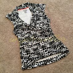 "Black and white abstract sleeveless top Black and white sleeveless top, abstract print, draped neckline, ruched sides, very stretchy. Length: 26"", bust: 19"", perfect condition. This item is used and may have imperfections. H&M Tops Tank Tops"