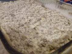 Sausage Biscuit & Gravy Casserole Recipe - OMG!  I think I want white gravy with lots of pepper rather than cream cheese, and I'd (of course) add garlic but sausage and gravy over biscuits is one of my favorite breakfasts! (popping an extra cholesterol pill just from looking at the picture . . . )