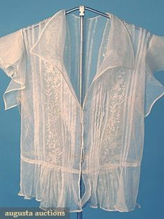 2 BOUE SOEURS TOPS, EARLY 20th C Both w/ Boue Soeurs NY labels: 1 cotton lawn hand embroidered vest w/ silver metallic trim, 1 cotton net blouse w/ embroidered organdy inserts. Front