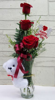 Three red roses in clear glass bud vase with a cute, plush teddy bear hugging the vase. Designed by Jen-Mor Florist in Dover, DE Valentine Flower Arrangements, Large Flower Arrangements, Valentine Decorations, Valentines Day Baskets, Valentines Flowers, Happy Valentines Day, Bud Vases, Flower Crafts, Red Roses