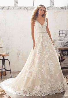 View Dress - Mori Lee Bridal SPRING 2017 Collection: 8124 - Morgan - Alençon Lace Appliqués and Medallions on Tulle with Crystal Beaded Trim and Scalloped Hemline | MoriLee Bridal