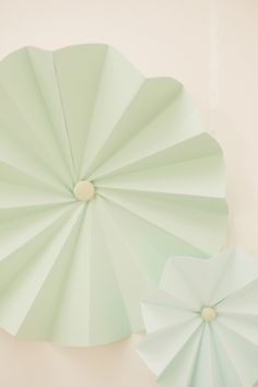 Pale green fanned wall decor perfect for a bridal or baby shower setting