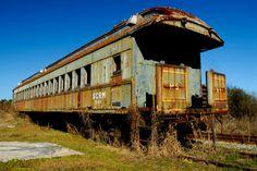 An abandoned passenger train car along Highway 701 in Conway, South Carolina