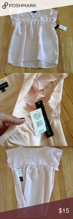 """My Michelle Blouse ✨Beautiful Blush Color Blouse✨Sheer✨100% Polyester✨High/Low Hem✨Measurements 19"""" Armpit to Armpit✨Approx. 24 1/2""""Front Length & 26"""" Back Length💥💥💥small pen mark shown in pic💥💥💥💥price reflects discount My Michelle Tops Blouses"""