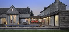 glass walled linking building opening to deck area | Furzey Hall Farmhouse | conversion and restoration MS Building | Architect: Waugh Thistleton Architects