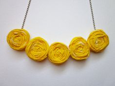 cute fabric rosette bib necklace - line the back with felt.