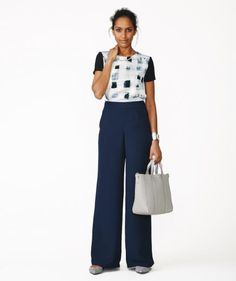 Printed Top + Wide-Leg Pants + Flats | Want to really get the most out of your wardrobe? Stick to pieces in colors that all work together, in silhouettes that you can mix, match, and layer for any situation or season. Let these 13 pieces—that style 15 complete outfits—be your inspiration.