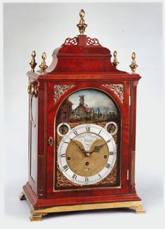 HOWARD WALWYN BENJAMIN BARBER Musical Automaton (London, circa 1770 to 1775) A very rare musical bracket clock by this well known George III period clockmaker. The elegant mahogany case has a bell top and reeded chamfers to the sides with a brass moulded base and ogee bracket feet. The arched door is bound with a brass moulding, and there are well cast brass sound frets to the front. The whole case has richly, figured mahogany veneers.