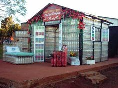 Plastic, Fantastic: Hand-Built Ecological Bottle House...maybe I could afford a greenhouse made of bottles!