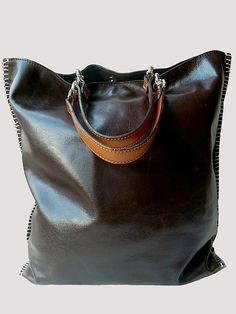 """HANDLES SOLD SEPARATELY, please enter as separate item.  Gajumbo, large tote in supple Napa leather, fully lined, 2 zippered pockets, cell phone pocket, key chain holder, handles sold separately. This is a very soft and buttery leather with a subtle shine to make it resist wear and tear. We don't call it scratch resistant, but pretty close. Oh so light weight! 16""""WIDE 17""""TALL 5.5""""DEEP"""