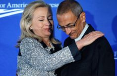 """U.S. Secretary of State Hillary Clinton (L) embraces Center for American Progress President and CEO John Podesta before addressing the centers' """"American Idea: A More Perfect Union"""" conference at the Decatur House October 12, 2011 in Washington, DC."""