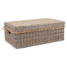 "Stow throws, media accessories, and everyday essentials in this wicker coffee table, showcasing a natural finish for understated appeal.  Product: Storage coffee tableConstruction Material: WickerColor: NaturalFeatures: Lid lifts to reveal storage compartmentDimensions: 18"" H x 49"" W x 29.5"" D"
