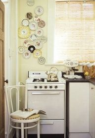 I love vintage kitchens...pretty plate display on skinny-long wall