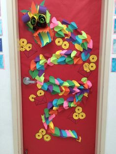 Chinese new year door idea I made up this year. The kids cut it hearts for Valentine's day and we made scales. Then they cut out money and made envelopes. They wrote new year luck on the coins. Ta da!! Classroom door success!