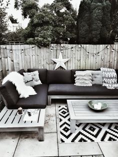 Creating a Scandi inspired outdoor seating area with a grey sofa set sheepskins for hygge and boho cushions # Garden Cushions, Garden Sofa, Boho Cushions, Cushions For Grey Sofa, Outdoor Sofa Cushions, Backyard Seating, Outdoor Seating Areas, Seating Area In Garden, Outside Seating Area
