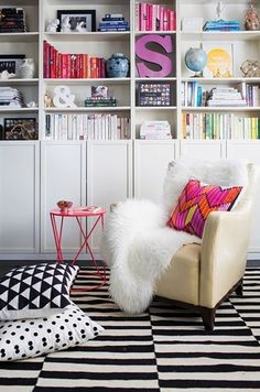 honey and fizz via Adore mag family room striped rug bookshelves