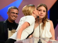 CANNES, FRANCE - MAY 26: (L-R) Director Abdellatif Kechiche smiles as actress Lea Seydoux kisses Adele Exarchopoulos on stage after La Vie DAdele receives the Palme dOr at the Inside Closing Ceremony during the 66th Annual Cannes Film Festival at the Palais des Festivals on May 26, 2013 in Cannes, France. (Photo by Pascal Le Segretain/Getty Images)