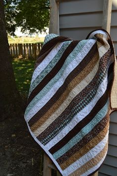 Blue and brown baby quilt by newlywoodwards, via Flickr