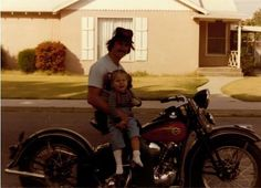 Sam taking the 1939 Knucklehead for a spin around the neighborhood in 1980. Oldest of the Mathews girls, Melanie, wasn't going for it!