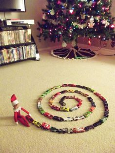 Our Elf On The Shelf played with the matchbox cars