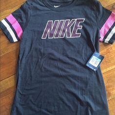 Nike Athletic Cut Tee Nike Athletic Cut Tee with Round Neck. 100% cotton. Brand new with Tags! Cute hot pink and white NIKE logo and striped sleeve. Nike Tops Tees - Short Sleeve