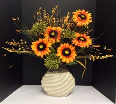 Early Fall 2014 Season Faux Floral Design & Arrangement: Deep Yellow Sunflowers, Olive Green Mums and yellow blooming wild grass on oval spiral ceramic vase filled with Spanish moss by http://nfmdesign.synthasite.com/