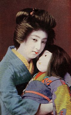 Geisha Sakae holding an Ichimatsu Doll 1908 | Flickr - Photo Sharing!