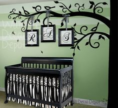 This is a vinyl tree. I painted one for a friend and she placed photos of her family Very cool Idea and easy to do in your own home