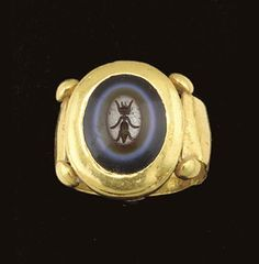 A ROMAN GOLD AND SARDONYX FINGER RING CIRCA 1ST-2ND CENTURY A.D.